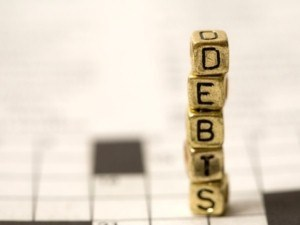 Lower debt a top consumer goal this year, but not through less credit card use